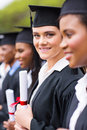 Young university graduates pretty standing in a row Royalty Free Stock Image