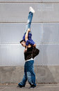 Young urban couple dancers hip hop dancing urban Royalty Free Stock Images