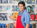 Young vendor welcoming at hardware shop portrait of handsome Stock Image