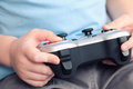 Young video gamer s hands using a gamepad cross processing Stock Images