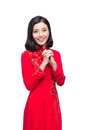 Young vietnamese woman in Ao Dai Dress with praying gesture wish Royalty Free Stock Photo