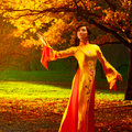 Young vietnamese woman in autumn park Royalty Free Stock Image