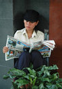 Young Vietnamese Woman Reading Newspaper Stock Photos