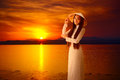 Young vietnamese woman on sunset background Royalty Free Stock Image