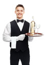 Young waiter with bottle of wine on tray portrait happy smiling white and stemware glass isolated white background Stock Images