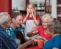 Young Waitress and Arguing Seniors Royalty Free Stock Photos