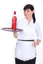 Young waitress on white background Royalty Free Stock Photography