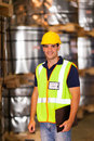 Young warehouse worker handsome inside storage Stock Photo