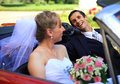 Young wedding couple in cabriolet car Stock Photo