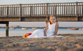 Young wedding a girl in a dress on the beach Stock Images