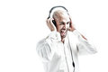 Young white dressed man having fun with music isolated on Royalty Free Stock Images
