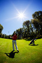 Young white male golfer red shirt Stock Photography