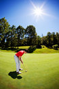 Young white male golfer red shirt Royalty Free Stock Photo
