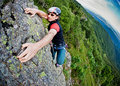 Young white man climbing a steep wall Royalty Free Stock Photo