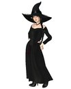 Young Witch in Black Hat and Dress Stock Photos