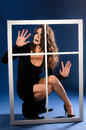 Young witch in black outside white window Royalty Free Stock Photo