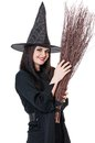 Young witch coquette with broom isolated on white background Stock Photo