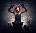 Young witch making witchcraft in a hallowen dungeon beautiful the over the smoky background halloween image Royalty Free Stock Photos