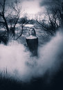 Young witch woman in black dress standing in the fog monochromatic shot Stock Image
