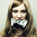Young woman with 100 US dollars in a mouth Royalty Free Stock Photo