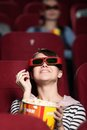 Young woman at the 3D cinema Stock Photography