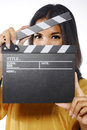 Young woman acting in action holding clapperboard isolated over white background Stock Image