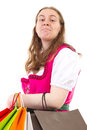 Young woman addicted to shopping in dirndl Stock Images