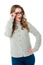 Young woman adjusting her spectacles charming on white background Royalty Free Stock Photos
