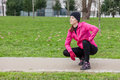 Young woman analyzing the track before running on a cold winter day in an urban park Royalty Free Stock Photos