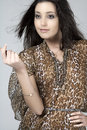 Young woman in animal print dress Royalty Free Stock Image