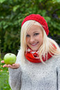 A young woman with an apple fruits and vegetables are the right vitamins for a cool fall or winter Royalty Free Stock Image