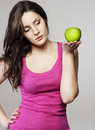 Young woman with an apple pretty Stock Photos
