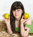 Young woman with apples Stock Image