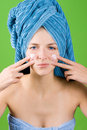 Young woman applying facial cream Royalty Free Stock Photo