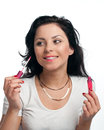 Young woman is applying lipgloss Royalty Free Stock Image