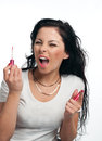 Young woman is applying lipgloss Stock Photography