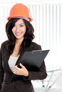 Young woman architect with orange helmet confident wearing hardhat Royalty Free Stock Images