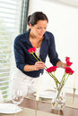 Young woman arranging flowers dinner table Stock Image