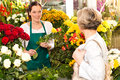 Young woman arranging flowers shop market selling Royalty Free Stock Photo