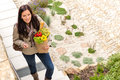 Young woman arriving home groceries shopping smiling Royalty Free Stock Photos