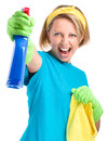 Young woman as a cleaning maid fiercely spraying liquid from blue sprayer isolated over white Royalty Free Stock Images