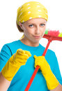 Young woman as a cleaning maid holding broom and pointing on you isolated over white Stock Images