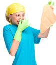 Young woman as a cleaning maid holding rag and pinching her nose because of bad smell isolated over white Stock Photography