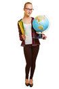 Young woman as geography teacher carrying a globe Stock Photo