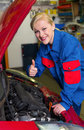 A young woman as a mechanic in a garage rare professions for women car is being repaired in the workshop Royalty Free Stock Photography