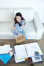 Young woman asking for help suffering stress doing domestic accounting paperwork bills Royalty Free Stock Photo