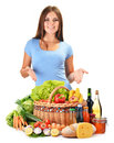 Young woman with assorted grocery products on white background Stock Images