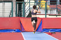 Young woman athlete performs the high jump pole vault Royalty Free Stock Photo