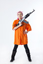 Young woman with automatic rifle Stock Photos