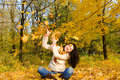 Young woman on the autumn leaf Royalty Free Stock Image